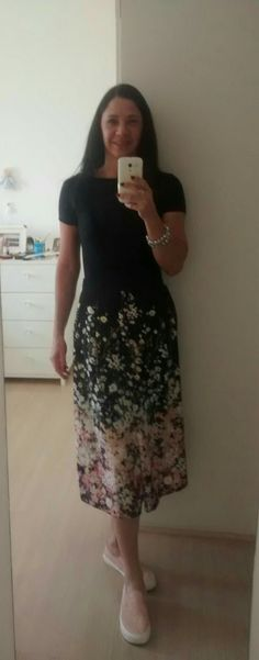 Me...  Black body, and midi skirt with slip on...