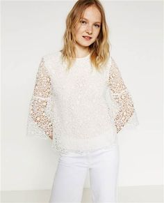 Wear this lace bell sleeve top with your favorite pair of jeans. You can even try wearing it with a skirt.