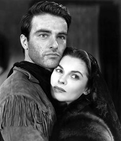 RED RIVER (1948) - Montgomery Clift as 'Matthew Garth' & Joanne Dru as saloon girl, 'Tess Millay' - Directed by Howard Hawks - United Artists - Publicity Still.