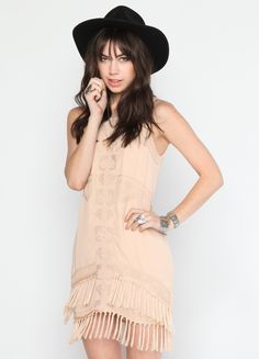 """Taupe tank dress featuring embroidery detail at front, fringed hem, and invisible zipper closure at back.    55% Cotton, 45% Polyester  31"""" length  Model is wearing size S"""