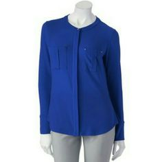 ADD SOPHISTICATION TO YOUR LOOK ***ROYAL BLUE TOP NWOT! SURE TO ADD A SOPHISTICATED LOOK WHEN PAIRED WITH A PAIR OF TROUSERS. THIS BLOUSE FEATURES A LIGHTWEIGHT FABRIC BLEND, POLYESTER & SPANDEX. A BUTTON DOWN FRONT,  LONG SLEEVE AND TWO POCKETS IN THE FRONT. AVAILABLE IN THE GORGEOUS  BLUE! Dana Buchman Tops