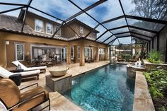 Relax in this screened-in patio and pool. New homes in FishHawk Preserve by Ashton Woods Homes in Lithia, FL.