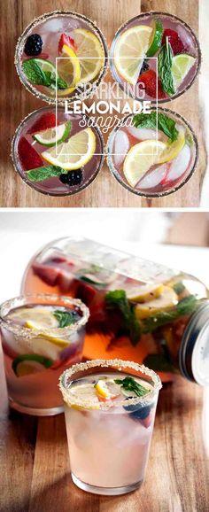 Sparkling Lemonade Sangria via The Whisking Kitchen | Combine Tito's Handmade Vodka, Moscato, lemonade, mint & fresh berries to make this fruity summer cocktail!