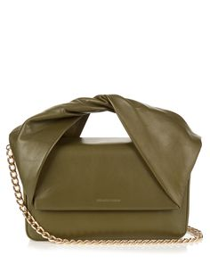 J.W.Anderson's olive-green lightly grained lamb-leather Twist clutch will lend any look contemporary flair. The distinctive shape is created by a twisted top handle and a boxy body that closes with a magnetic fastening. It comes with a detachable gold-tone chain shoulder strap and is a perfect foil to this season's feminine ruffled pieces.