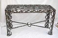 Horseshoe Sofa Table  $1995- My grandfather made a coffee table and two in tables out of horse shoes.... LOVE IT