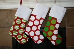 Red Modern Christmas Stocking with White Dots and Ball Fringe. $29.00, via Etsy.