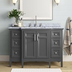 null Effortlessly meld traditional charm and contemporary flair with this vanity base. Crafted from solid birch wood, it features a single cabinet and 6 (!) drawers for plenty of concealed storage space. Up top, its undermount rectangular ceramic sink is surrounded by Italian carrara marble in gray and white. This freestanding piece comes complete with matching marble backsplash, a finished back, and brushed nickel hardware. Bonus: each of the drawers are set on full extension glides for… Dark Vanity Bathroom, Grey Bathroom Cabinets, Bathroom Hardware, Bathroom Vanities, Bathroom Vanity Designs, Bathroom Interior Design, Grey Bathrooms Designs, Small Grey Bathrooms, Guest Bathrooms