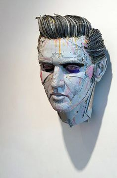 Celebrity busts made with cardboard, glue, and screws (Elvis)