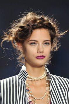 Nicole Miller The crown braid gets a modern and messy makeover with added texture from flyaways you don't need to smooth out.   Read more: Braids from Spring Runways - Braided Hairstyles for Spring - ELLE  Follow us: @ElleMagazine on Twitter | ellemagazine on Facebook  Visit us at ELLE.com
