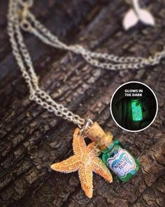Legend has it that mermaids tears possess the magical power to protect and heal those who owns it. It is also believed that a mermaids tears can help guide one to find their true love. This beautiful handmade charm features a corked glass vial pendant filled with magical shimmery sea green mermaid tears accented with a mini starfish.  When held up to the light for 20 minutes the charm can be charged and the shimmery tears will have a magical glow in the dark. It also features an extention…