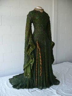 Ellen Terry was famous for her dramatic roles, and to enhance her interpretation of Lady Macbeth in the late 1880s she wore an extraordinary emerald and sea green gown adorned with the iridescent wings of the jewel beetle.