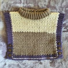 This toddler-sized poncho sweater works up beautifully using the NEW Caron  Cakes yarn.