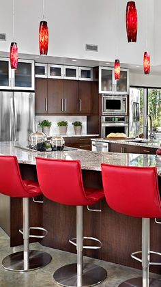 The red accent color truly completes this kitchen!