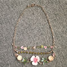 Flower necklace Very pretty flower necklace with gem stones in it. Not missing stones or faded!  Jewelry Necklaces