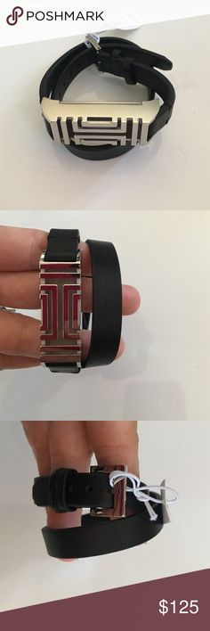 { Tory Burch } Fitbit Fret Double wrap bracelet Tory Burch Fitbit Fret Double Wrap bracelet. I wear this as just a bracelet because it's so cute! Wraps around twice and has a buckle style latch. Back opens up. In black and silver colors. Super adorable! Tory Burch Jewelry Bracelets