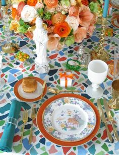 Orange and Gold. . . FUN.  Floral China on an Orange Ginori Charger on a mosaic table with aqua napkins.