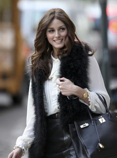 I really want a faux fur vest this winter - and the black is awesome! Love it!!