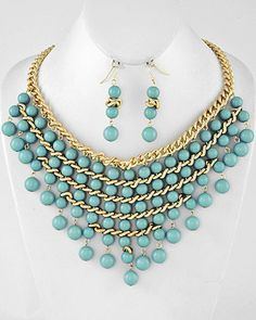 "This is a really Pretty Gold Tone Chain  Necklace & Earring set with Aqua Blue Beads    Beautiful Shape    I am sure you will receive many compliments when you wear this set.    Add Color to that little Black Dress    Brighten up your white blouse    Dress up your Jeans    The possibilities are endless    •   Length : 18"" + EXT  •   Earring : 2 1/4"" L"
