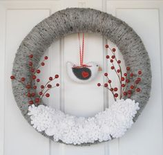 This cute Christmas or winter wreath has everything! The straw wreath base is wrapped in a gray tweed yarn, and features a big patch of snowy white