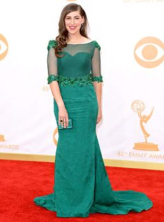 Mayim Bialik went from geek to glam in an emerald gown, jewelry by Bellarri and Takat, and a Swarovski clutch at the 2013 Emmys.