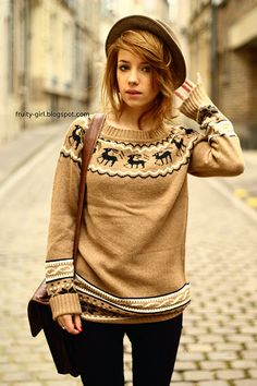 Even my favorite french blogger knows that reindeer sweaters are where it's at. Then again, all the best people do.