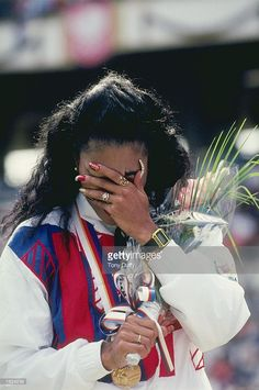 Florence Griffith-Joyner of the USA overcome with emotion after receiving a gold medal at the 1988 Olympic Games in Seoul, South Korea. Griffith-Joyner won gold medals in the 100 and 200 Metres events. Flo Jo, American Athletes, Female Athletes, Florence Griffith Joyner, Jackie Joyner Kersee, 1988 Olympics, African American Beauty, Vintage Black Glamour, Black Goddess