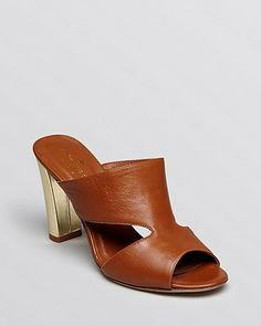 The backless slip on heel/wedge was everywhere this Fashion Month -- it's the freshest update out there if you're looking for new summer sandals.Kate Spade Open Toe Slide Mule Sandals via StyleList