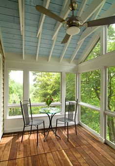 {upstairs addition} enclosed porch with painted ceiling, white wooden beams