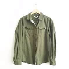 J. Crew Army Green Button Down Retail. Size 6 but fits more like a 2 in my opinion. I am more than happy to provide measurements upon request. Tag marked through to prevent in store returns. Excellent condition with no rips it stains. Very minimal normal wear. First picture filtered. 100% cotton. No trades or PayPal. J. Crew Tops Button Down Shirts