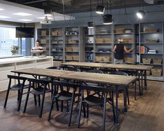 Spacesaver Solutions installed rolling shelving to neatly and efficiently house HOK Toronto's library on either side of communal tables in the firm's kitchen area.