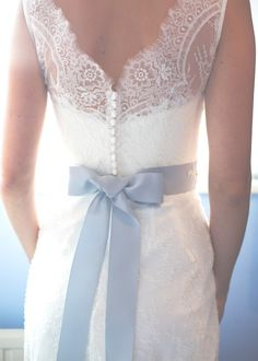 Love the ribbon around the waist- adds definition and color. Maybe with an A-line, skirt, though?