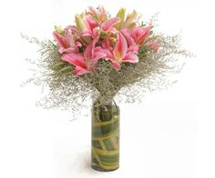 Glass Vase arrangement of 6 pink oriental lilies with white fillers