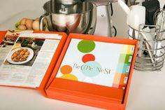 The Recipe Nest is a recipe storage system that looks very easy to use. You don't have to worry about hole punching anything, it has a sheet protector and an easel to hold recipes while you work and it all folds up to look nice for storage.    Yup. Totally want.