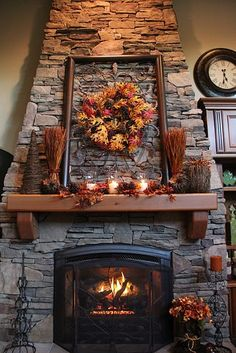 thanksgiving mantel! Love this cabin's fireplace and mantel decorated with a cute wreath idea! #fireplace #falldecor #wreath