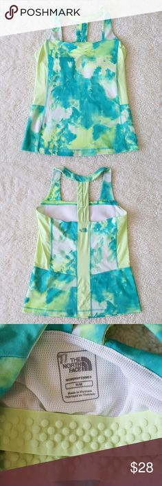 The North Face watercolor athletic top Like new, no flaws, unique watercolor with side panels, lined, super cute back detail, fits true to size, fitted style, slimming effect. Bundle! The North Face Tops