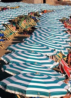 Stripe Parasols by the Sea <3