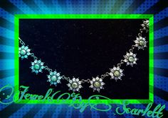 This is a gorgeous Blue and Peridot Crystal Flower necklace for a young lady for her first dance or her 13th Birthday or any occasion will do! #girls #special occasions #blue crystals #peridot #gunmetal chain #flowers #beautiful #young lady  www.jewelsbyscarlett.com  www.etsy.com/shop/jewelsbyscarlett   Shop this product here: http://spreesy.com/JewelsByScarlett/77   Shop all of our products at http://spreesy.com/JewelsByScarlett      Pinterest selling powered by Spreesy.com