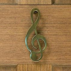 "Treble Clef Door Knocker. New. Available in antique brass, bright verde, brushed nickel, and dark oil rubbed bronze. 6 1/8"" x 2 3/8"""