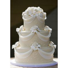 white wedding cake with red roses | Tier Fondant Covered Wedding Cake With Draped Swag Of White Roses