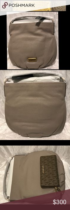 """Authentic Marc Jacobs Q Hillier Leather Hobo You'll love this large minimalist Hobo style bag! Don't concern yourself with other people's make up stains, pen marks, dirty handles or scratches. Buy this in new, just-out-of-the-store condition!  I've pictured the Michael Kors Continental wallet in Mocha to show its size. The wallet is sold in a separate listing in my closet and goes well with this purse! Bundle and save on shipping!  Approx. 13.5""""H x 14.5""""L x 5""""W Approx. 5.5"""" handle drop…"""