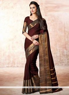 This delightful diva accoutre features unique styling and unusual material. Add grace and charm to your appearance in this beautiful maroon cotton   casual saree. Look ravishing clad in this attire wh...
