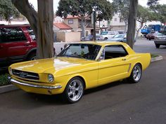 Yellow Mustang by Morven, via Flickr
