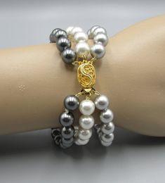 Triple Strand Pearl Bracelet | Multi Colored Pearl Bracelet | Hand Knotted Pearls | Bridal Jewelry #SwarovskiPearls #WhitePearlBracelet #CrystalPearls #PearlJewelry #WeddingJewelry #GemstoneBracelets #BridalJewelry #BridesmaidBracelets #TripleStrandPearl #MultiColoredPearl Gemstone Bracelets, Pearl Bracelet, Pearl Jewelry, Wedding Jewelry, Jewelry Bracelets, Christmas Jewelry, Diy Christmas, Jewelry Ideas, Unique Jewelry