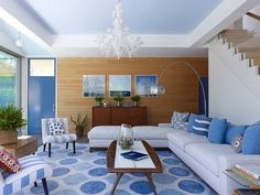 Living room in white and blue and wallcovering Wood