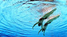 Mi Hyang and Yon Hui Jong of North Korea take part in the women's duets synchronized swimming free routine preliminary.