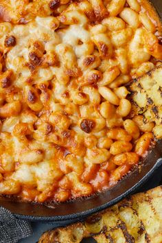 Cheesy White Bean-Tomato Bake Recipe - NYT Cooking read notes about additions and less cheese Giada De Laurentiis, Baked Tomato Recipes, White Bean Recipes, Crockpot, Pasta, Baked Beans, Baked White Beans Recipe, Baking Recipes, Healthy Snacks