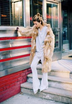 Top knot. Bell bottom jeans. Oversized shirt. Faux fur jacket. I woke up like this!