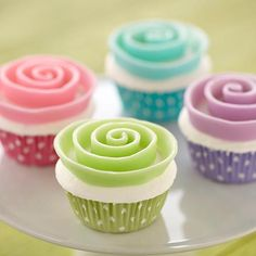 Two-Tone Candy Clay Ribbon Flower Cupcake - Transform Candy Melts candy into candy clay ribbons that are lighter on front and darker on back