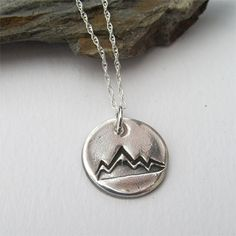 This petite silver mountain necklace has pretty mountain range design and is perfect for outdoor enthusiasts and nature lovers.  Made of pure