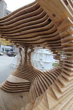 Interesting creation of flowing form from a series of stacked milled planes    Sukkahville Design Competition Winning Exhibition: 'Hegemonikon' / Christina Zeibak and Daphne Dow